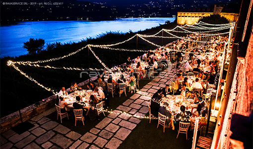 wedding dinner string light terrace lake view
